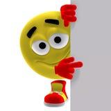 El emoticon amarillo fresco y divertido dice mirada aquí Foto de archivo