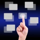 El empujar manualmente en una pantalla táctil Fotografía de archivo libre de regalías