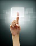 El empujar manualmente en una pantalla táctil Imágenes de archivo libres de regalías