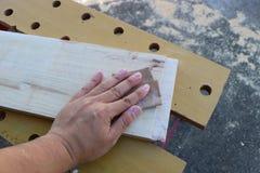 El enarenar de la mano Fotografía de archivo