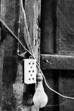 El enchufe y el bulbo viejos Foto de archivo libre de regalías