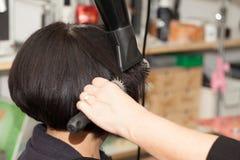 El enderezarse del pelo Imagen de archivo libre de regalías