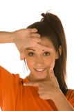 El enmarcar de la cara de la mujer Imagen de archivo libre de regalías