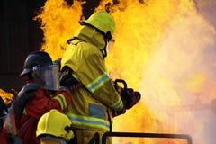 El entrenamiento del bombero Imagenes de archivo