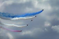 El equipo aeroacrobacia de la exhibición de las flechas rojas famosas Foto de archivo libre de regalías