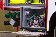 El equipo de seguridad contra incendios en un borrado agrupa el vehículo imágenes de archivo libres de regalías