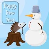 El erizo está construyendo un muñeco de nieve Feliz Año Nuevo Foto de archivo libre de regalías