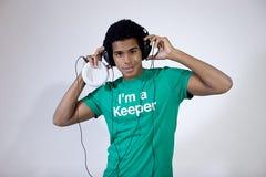 El escuchar adolescente la música Foto de archivo