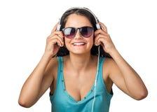 El escuchar con las auriculares Imagen de archivo libre de regalías