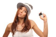 El escuchar los auriculares de la música de danza Fotos de archivo libres de regalías