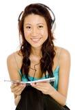El escuchar un CD Fotografía de archivo libre de regalías