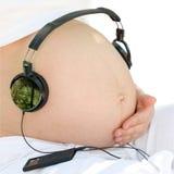 El escuchar una música Imagen de archivo libre de regalías