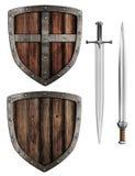 El escudo y las espadas del viejo caballero medieval de madera fijados imagen de archivo