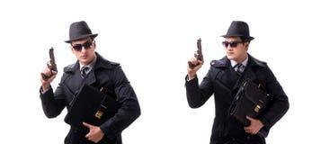 El espía del hombre con la arma de mano aislada en el fondo blanco fotos de archivo libres de regalías