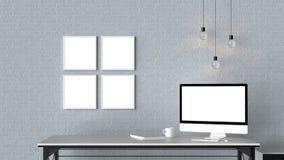 El espacio de trabajo moderno con los marcos vacíos aislados en la pared de ladrillo y es Fotografía de archivo libre de regalías