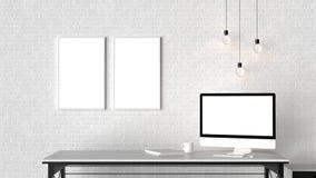 El espacio de trabajo moderno con los marcos vacíos aislados en la pared de ladrillo y es Imagenes de archivo