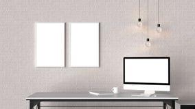 El espacio de trabajo moderno con los marcos vacíos aislados en la pared de ladrillo y es Imágenes de archivo libres de regalías