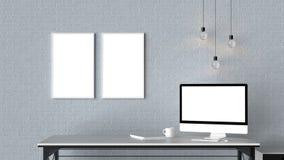 El espacio de trabajo moderno con los marcos vacíos aislados en la pared de ladrillo y es Fotos de archivo