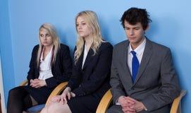 El esperar de tres personas Fotografía de archivo libre de regalías