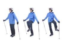 El esquiador demuestra el ejercicio del calentamiento para esquiar Imágenes de archivo libres de regalías