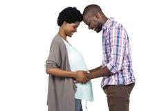 El estómago conmovedor de la mujer embarazada del hombre Imagen de archivo