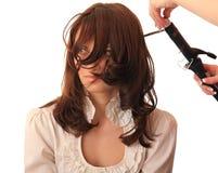 El estilista hace el pelo Foto de archivo