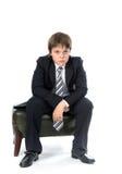 Muchacho joven que se sienta en silla Imágenes de archivo libres de regalías