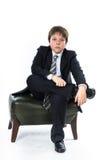 Muchacho joven que se sienta en silla Imagen de archivo