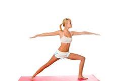 El estirar de la mujer de la yoga Imagen de archivo