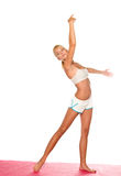 El estirar de la mujer de la yoga Fotografía de archivo