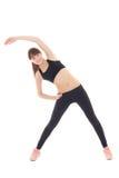 El estirar deportivo joven de la mujer aislado en blanco Imagen de archivo