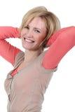 El estirar rubio de la mujer Foto de archivo libre de regalías