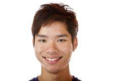 El estudiante asiático feliz está sonriendo Foto de archivo