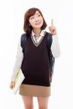 El estudiante bastante asiático de los jóvenes indica el espacio lateral Fotografía de archivo