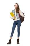 El estudiante bonito que sostiene los libros de texto aislados en blanco Imagenes de archivo