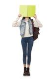 El estudiante bonito que sostiene los libros de texto aislados en blanco Imagen de archivo