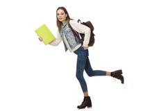 El estudiante bonito que sostiene los libros de texto aislados en blanco Fotos de archivo