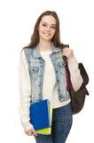 El estudiante bonito que sostiene los libros de texto aislados en blanco Fotografía de archivo libre de regalías