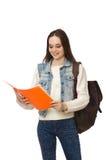 El estudiante bonito que sostiene los libros de texto aislados en blanco Imágenes de archivo libres de regalías
