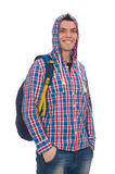 El estudiante caucásico sonriente con la mochila aislada en blanco Foto de archivo