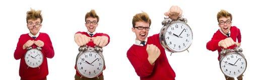 El estudiante con el despertador aislado en blanco Imagen de archivo