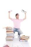 El estudiante con el libro aislado en un blanco Imagenes de archivo