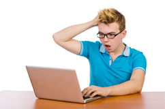 El estudiante con el ordenador portátil aislado en blanco Imagen de archivo