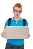 El estudiante con el ordenador portátil aislado en blanco Foto de archivo