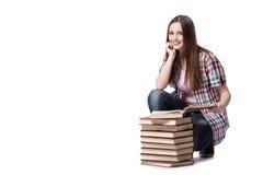 El estudiante con los libros aislados en el fondo blanco Imagenes de archivo