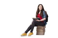 El estudiante con muchos libros aislados en el blanco Imagen de archivo libre de regalías