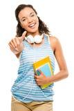 El estudiante de mujer feliz de la raza mixta manosea con los dedos para arriba Fotografía de archivo