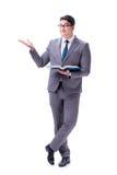 El estudiante del hombre de negocios que lee un libro aislado en el fondo blanco Foto de archivo libre de regalías