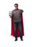 El estudiante del superhéroe con los libros aislados en blanco Foto de archivo