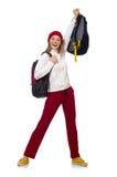 El estudiante divertido con la mochila aislada en blanco Foto de archivo
